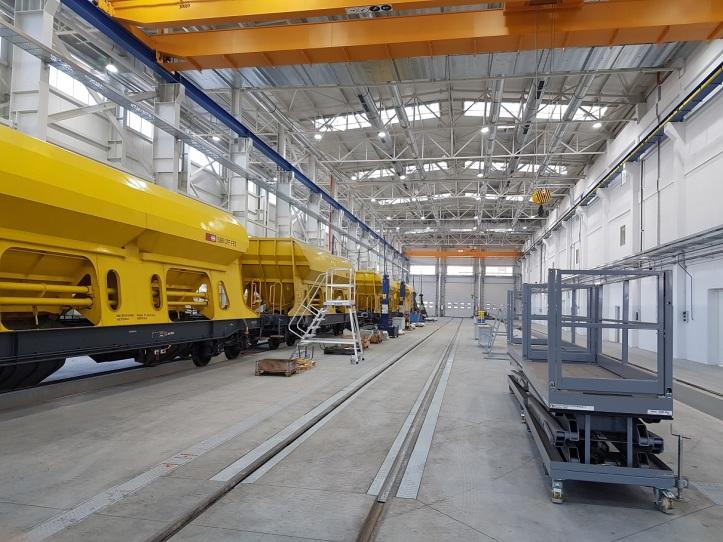 ŽOS Trnava sprevádzkovala novú modernú halu pre strojársku výrobu a výrobu aopravy vagónov aelektrických rušňov.